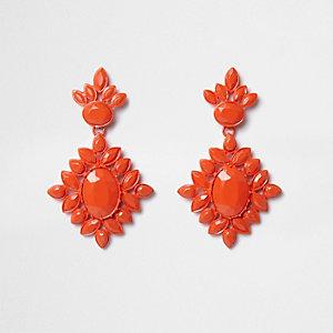 Oranje oorhangers met ingelegde siersteentjes
