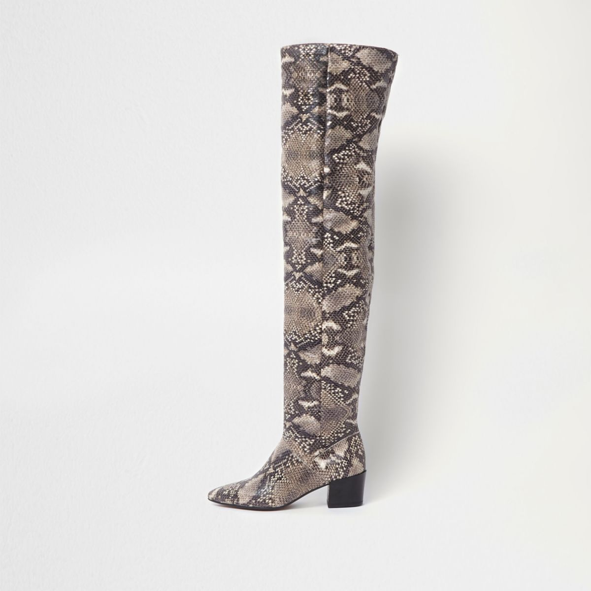 Beige snake slouch over the knee boots