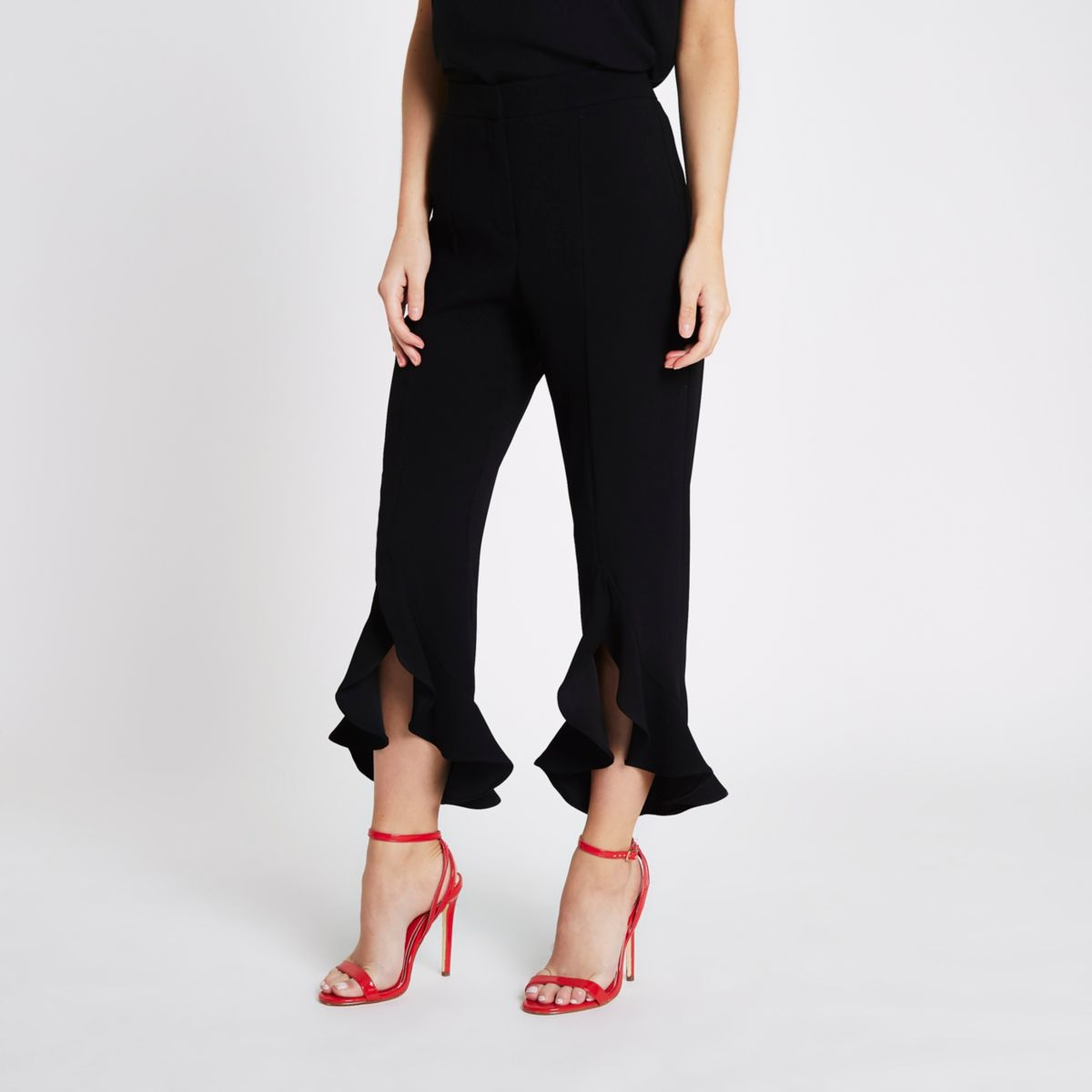 Petite black split frill hem trousers
