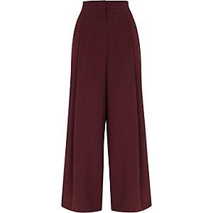 Pantalon large bordeaux à rayure sur le côté