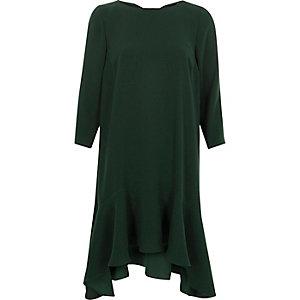 Robe trapèze verte avec ourlet à volant et liens à nouer au dos