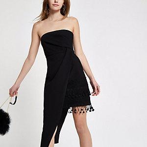 Robe moulante noire avec ourlet à pampilles