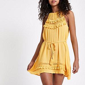 Gele diepuitgesneden jurk met mesh