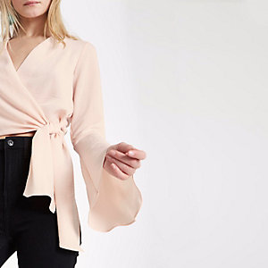 Light pink wrap flare sleeve crop top