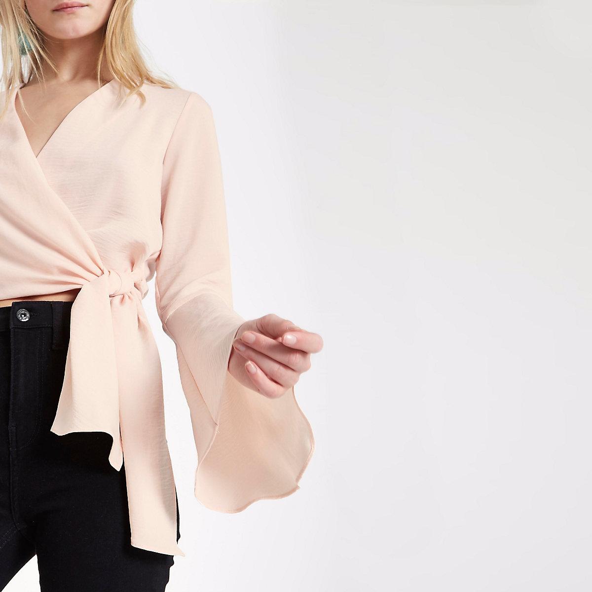 Light pink wrap flare sleeve crop top