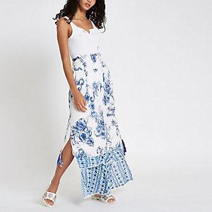 Jupe longue bleue à fleurs plissée ornée de sequins