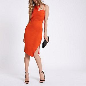 Robe mi-longue orange moulante à découpes au col