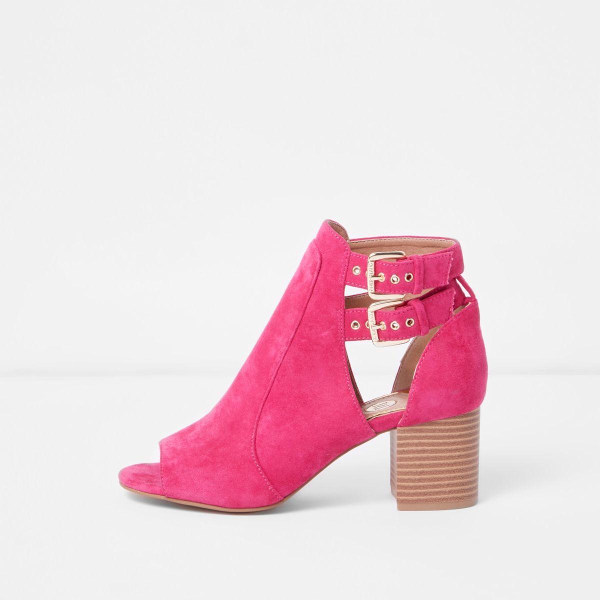 Pink buckle block heel shoe boots