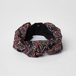 Schwarzes Stirnband mit Knoten und Stickerei