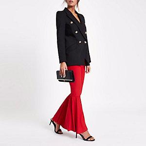 Rode wijduitlopende jersey broek met hoge taille
