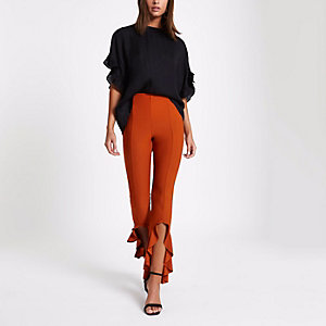 Rust orange flared frill hem trousers