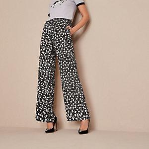 Holly Fulton – Pantalon large à fleurs noir