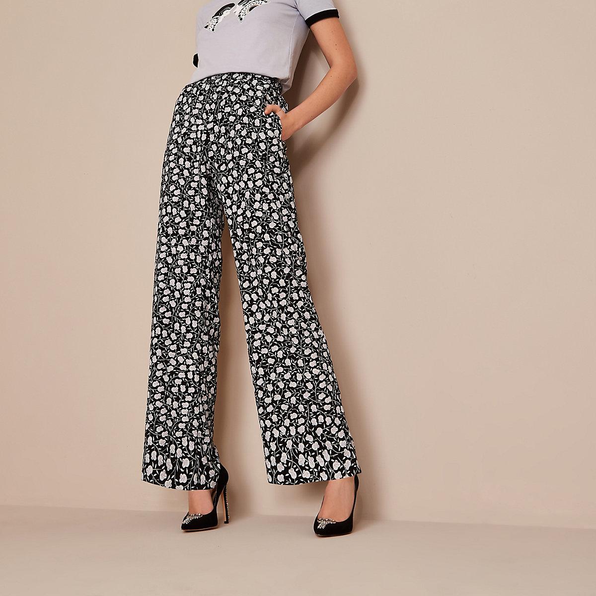 Holly Fulton - Zwarte broek met bloemenprint en wijde pijpen