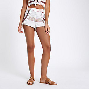 Cream aztec embroidered beach shorts
