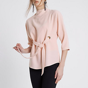 Light pink eyelet tie up front high neck top