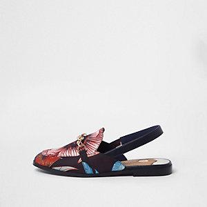 Schwarze Loafer mit Ketten- und Blumenverzierung
