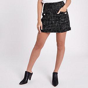 Petite – Mini-jupe en maille bouclée pailletée noire avec poches