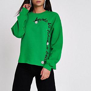 Groen sweatshirt met 'apres la'-broche