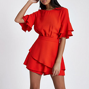 Red frill sleeve tie back playsuit