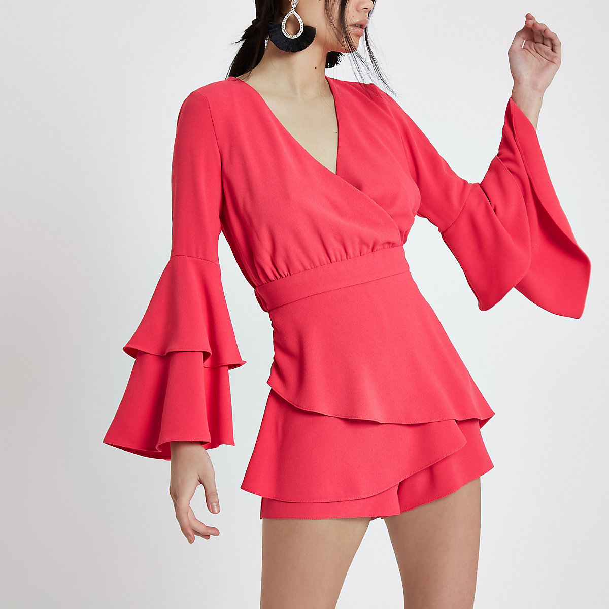 Bright pink frill sleeve wrap playsuit