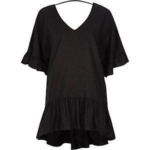 Ruimvallend zwart T-shirt met V-hals en peplum
