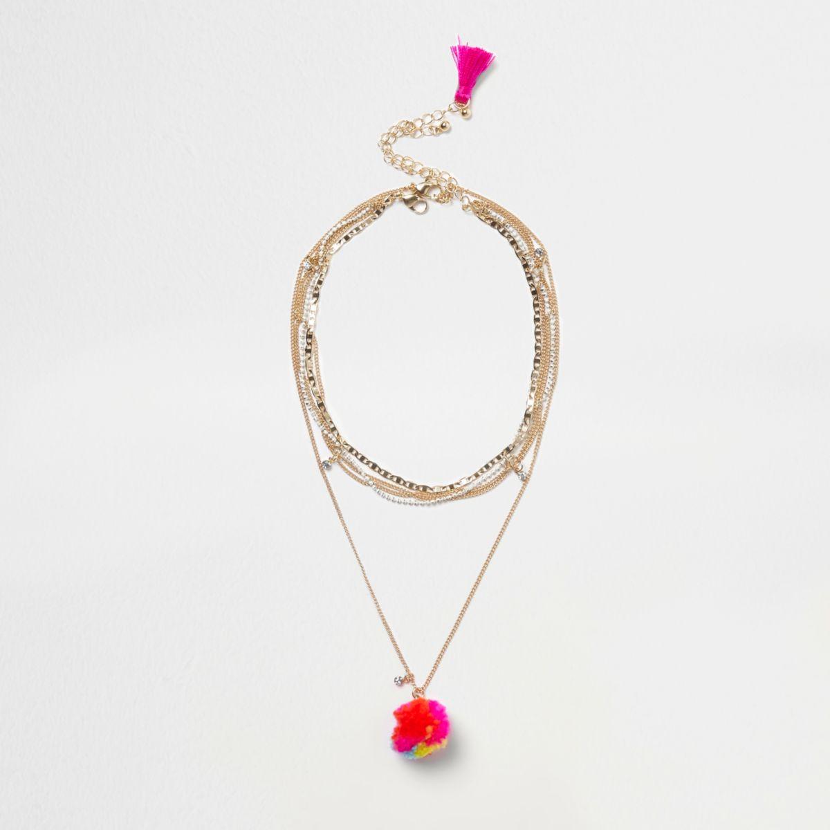 Gold tone tassel pom pom necklace