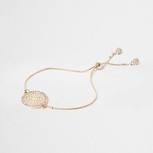 Gold tone filigree lariat bracelet