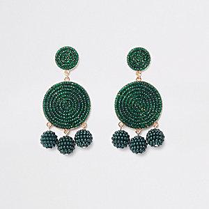 Pendants d'oreilles verts à trois boules en perles