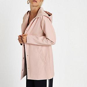 Light pink waterproof hooded rain mac