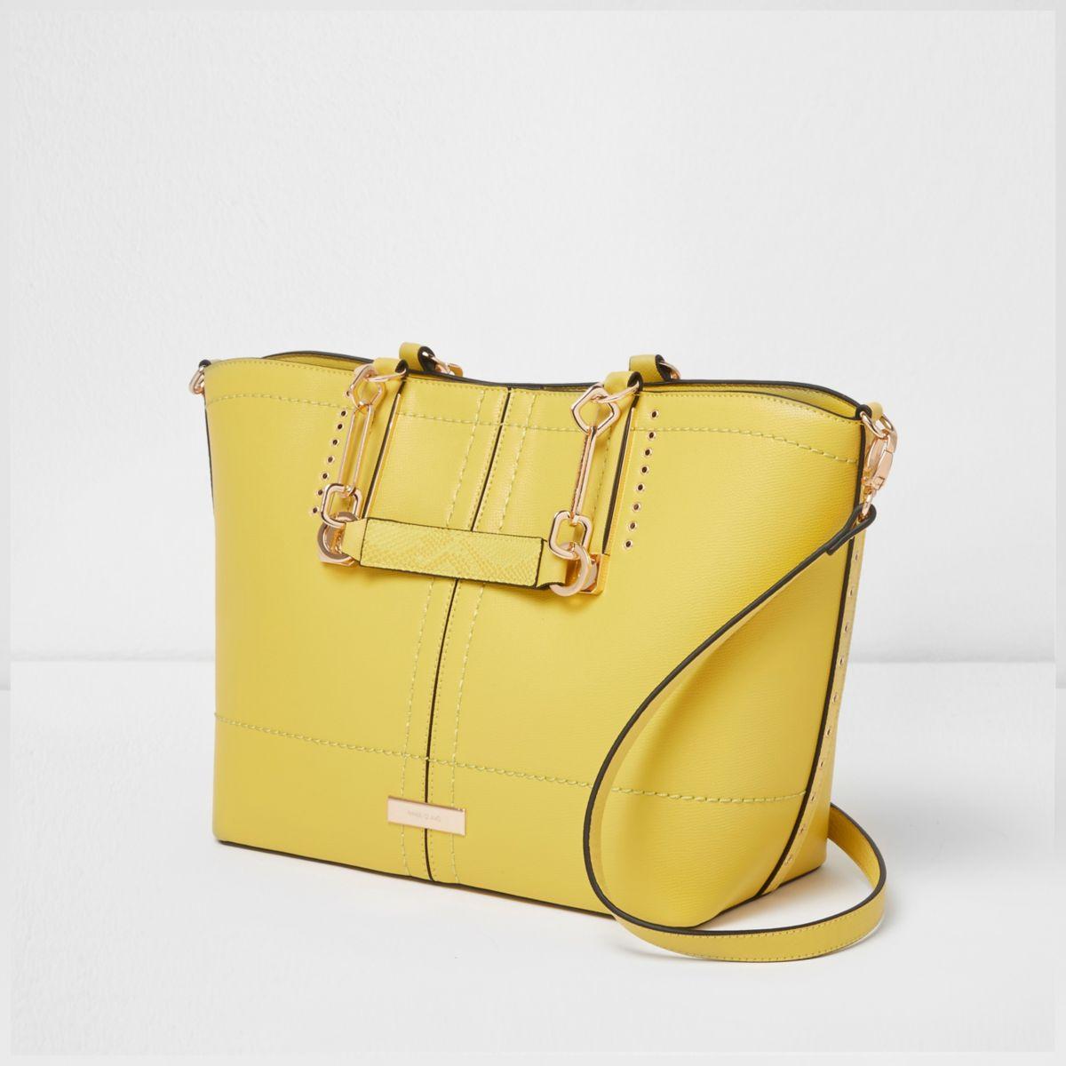 Gele handtas met zij-inzetten