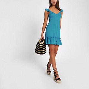 Blauwe midi-jurk met strik achter