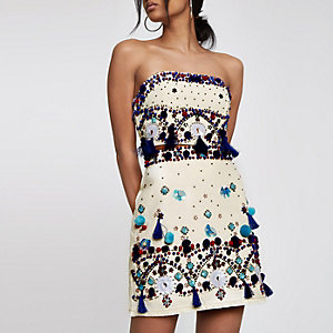 Cream tassel embellished mini skirt