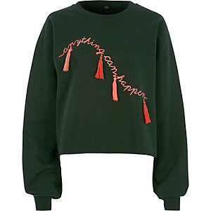 Groen sweatshirt met 'anything can happen'-print en kwastje