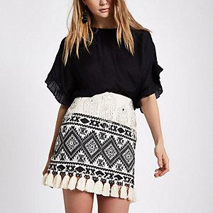 Cream embroidered tassel hem mini skirt