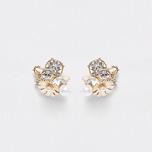 Boucles d'oreilles dorées ornées de strass et de perles