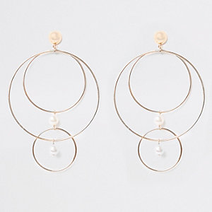 Gold tone multi hoop pearl stud earrings