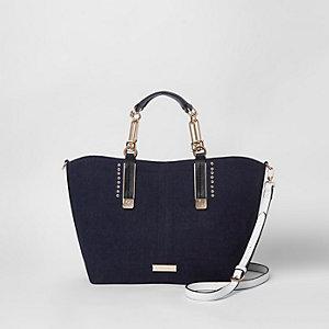 Blauwe handtas in denimlook met oogjes en studs