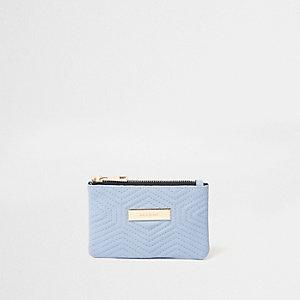 Mini porte-monnaie bleu matelassé sur le devant