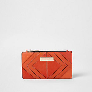 Smalle uitvouwbare oranje portemonnee met ruitjespaneel