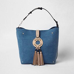 Blauwe tas in denimlook met ring en kwastjes