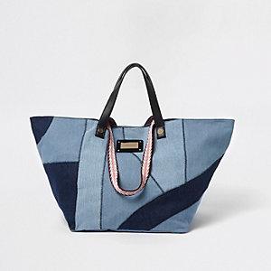 Blauwe denim oversized shoppertas met patchwork