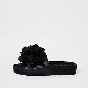 Zwarte espadrille-instappers met bloemen