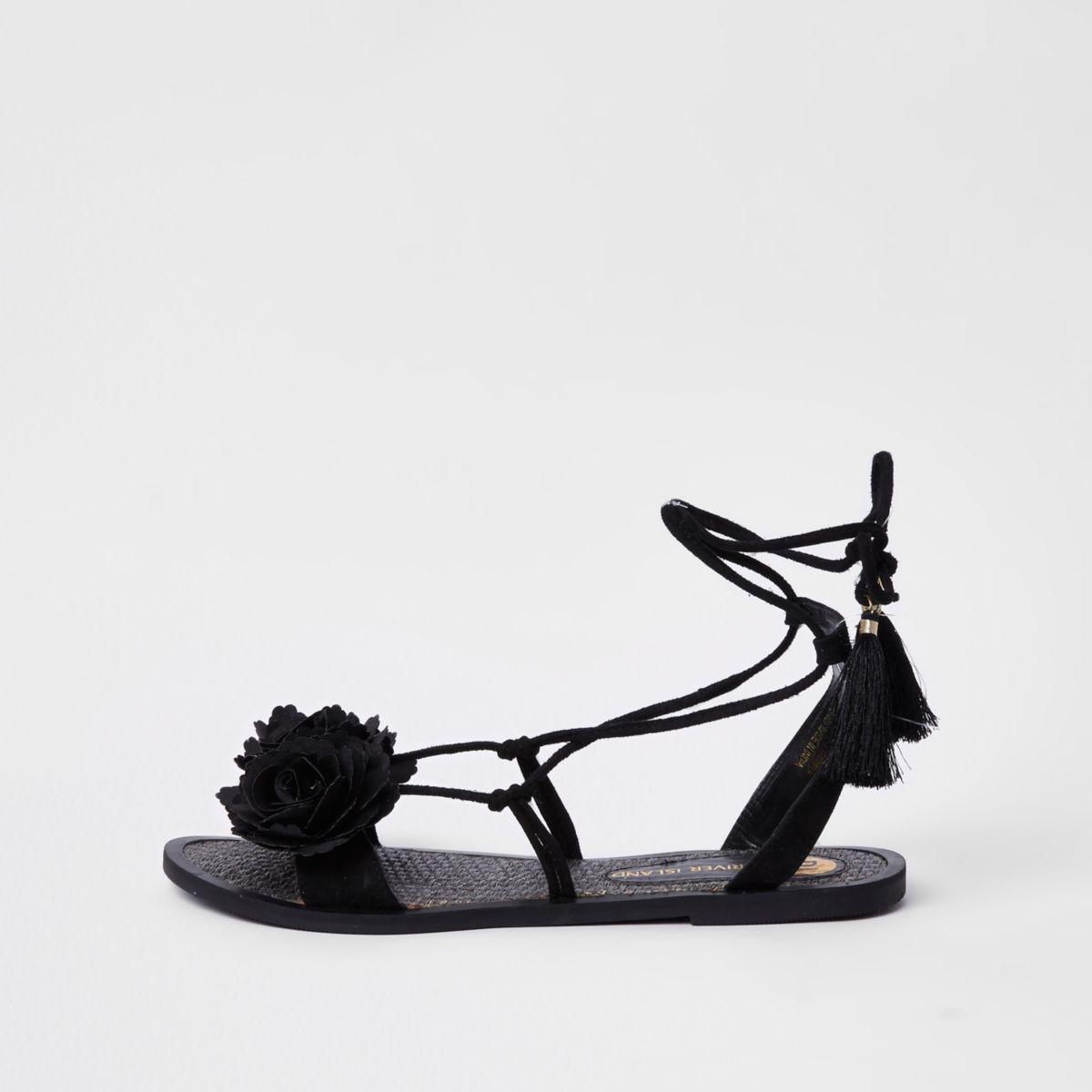 Zwarte gebloemde sandalen met strik bij de enkel