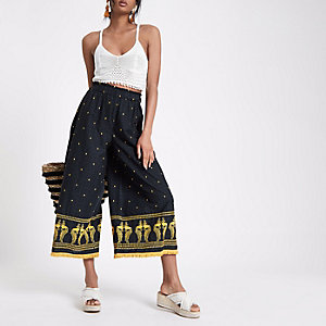 Navy embroidered fringe hem pants