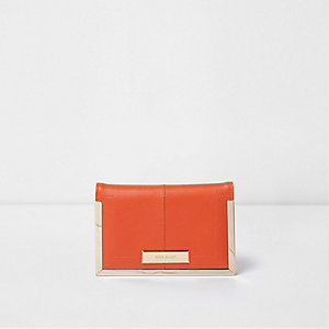 Orange and gold tone passport holder