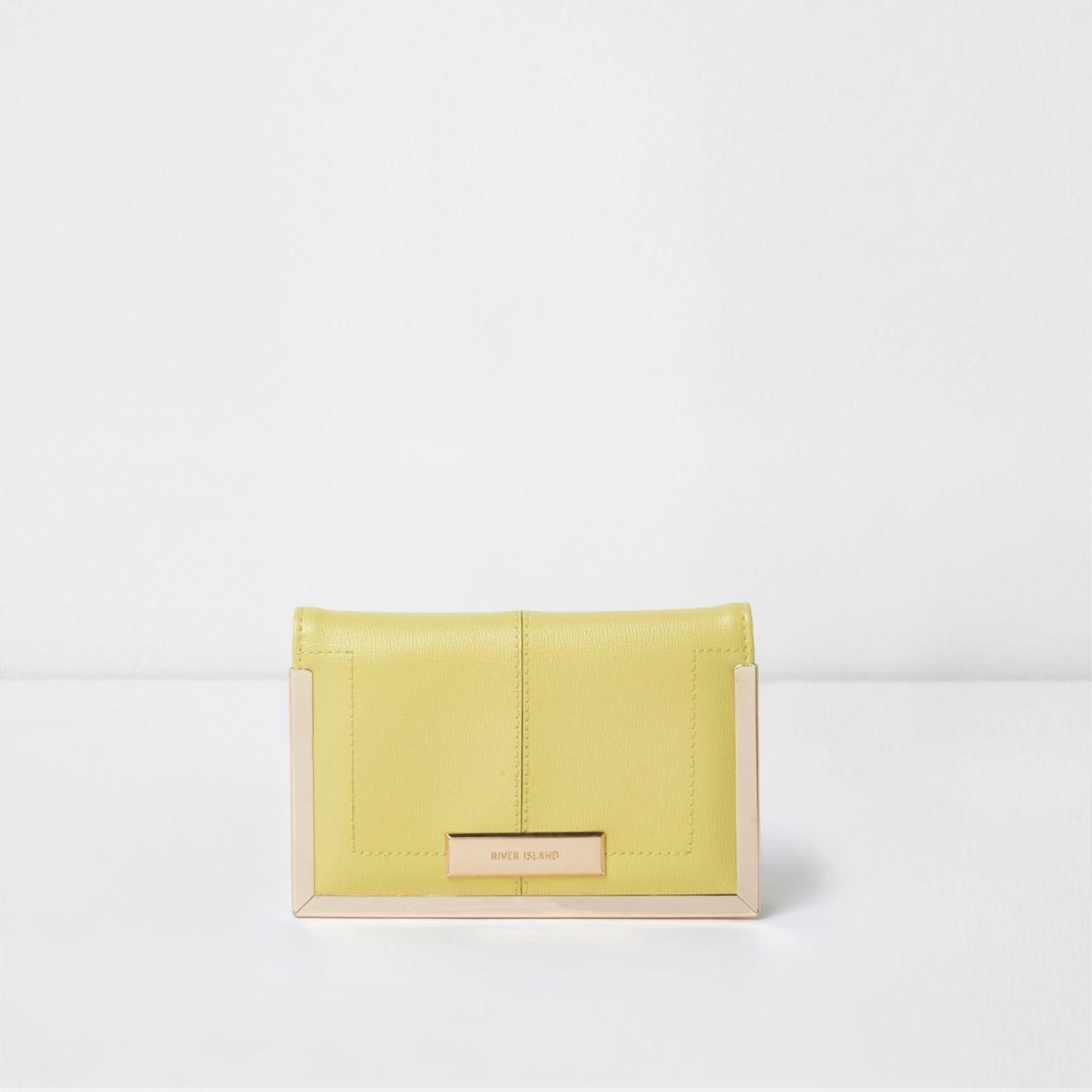 Light yellow and gold tone passport case