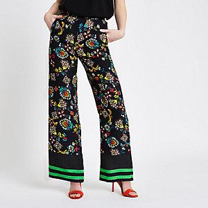 Zwarte broek met wijde pijpen en bloemenprint