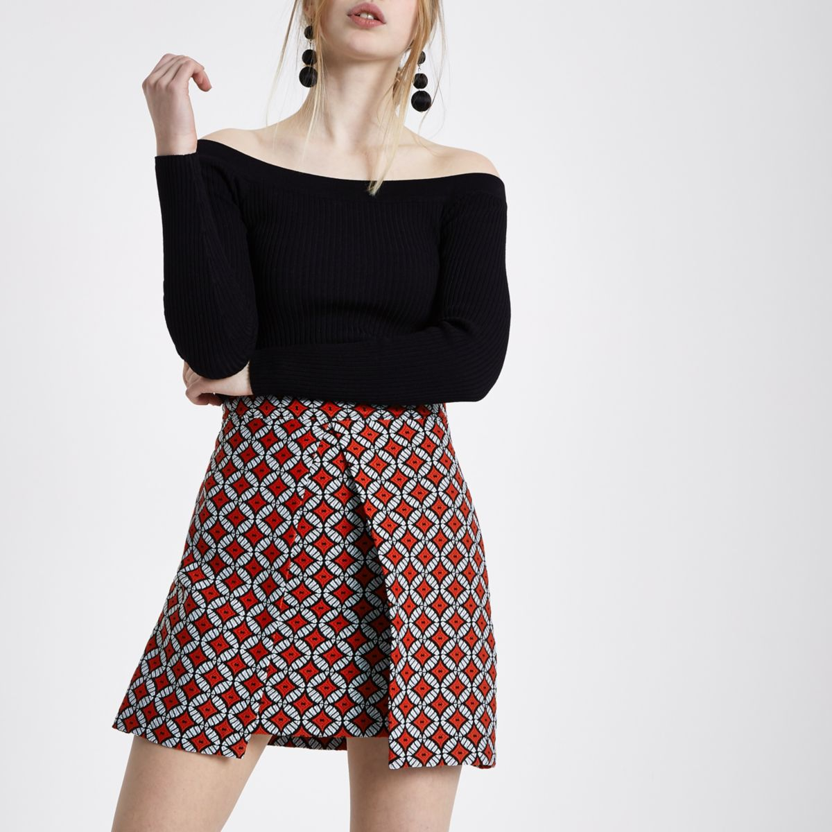 Red geo jacquard wrap front mini skirt