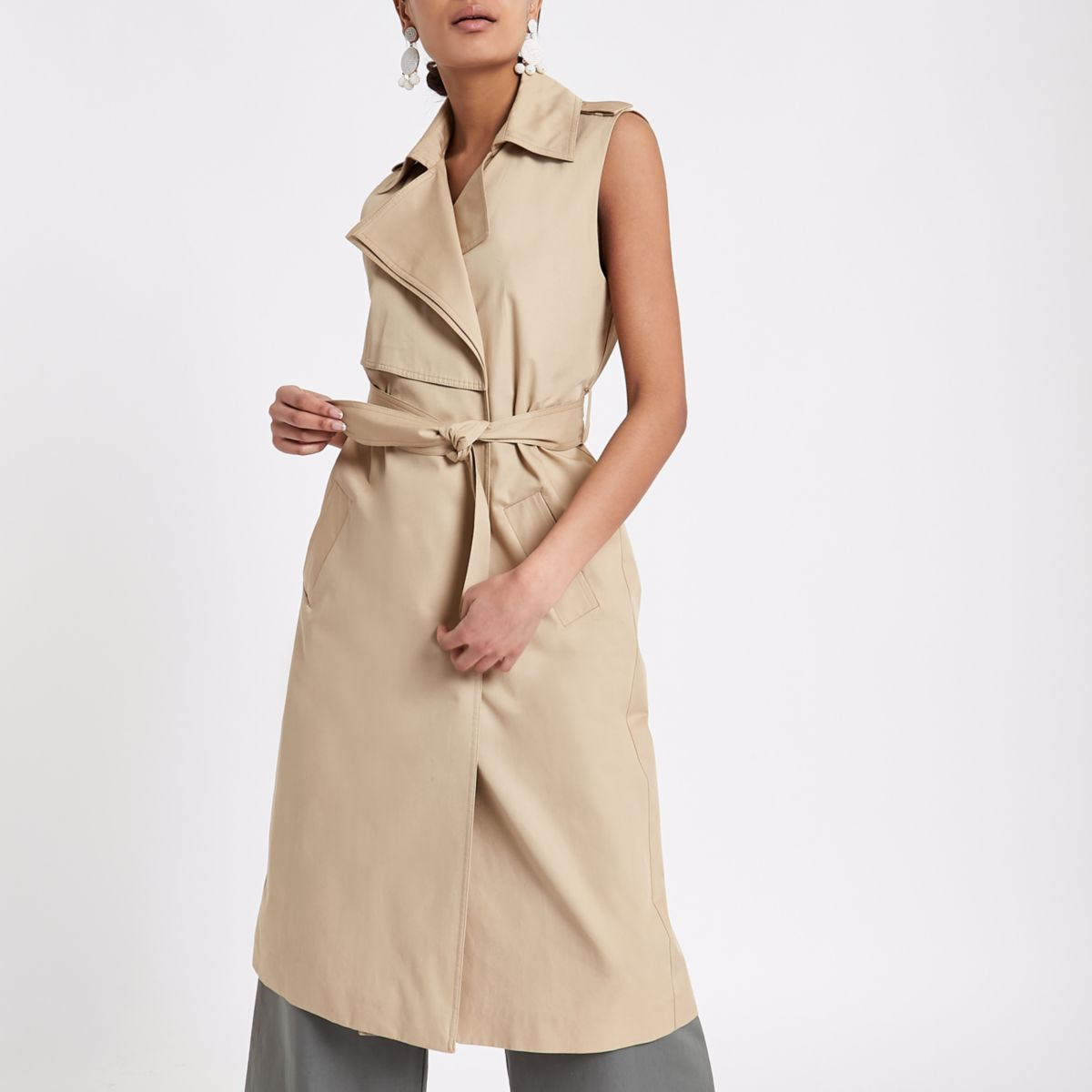 Beige sleeveless belted trench coat