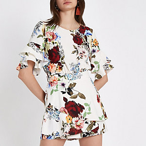 Cream floral frill sleeve tie back playsuit